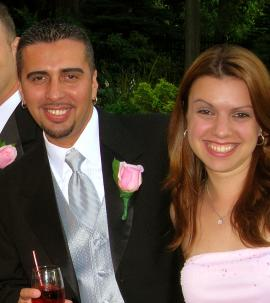 Michelle and Luis celebrating at a friend's wedding!