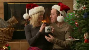 stock-footage-couple-sips-hot-chocolate-by-the-fireplace-and-christmas-tree